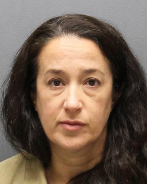 This Thursday, Dec. 18, 2014 photo provided by the Yonkers, N.Y. Police Department shows Emily Dearden. Dearden, a psychologist with the New York Police Department, has been charged with attempted murder for allegedly shooting her sleeping husband in the head in November, 2013. Her husband, Kenneth Dearden, said his wife had a longtime lover and wanted to end the marriage while avoiding a messy divorce. (AP Photo/Yonkers, N.Y., Police Department)