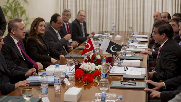 Turkish Prime Minister Recep Tayyip Erdogan, left, talks with his Pakistani counterpart Raja Pervaiz Asharf, right, in Islamabad, Pakistan, on Wednesday, Nov. 21, 2012, after Erdogan arrived in Pakistan for the D-8 summit.  The economic bloc of eight D-8 developing nations with large Muslim populations meet as diplomats help to secure a Gaza truce and heavy fighting continues to rage in Syria. (AP Photo/B.K. Bangash)