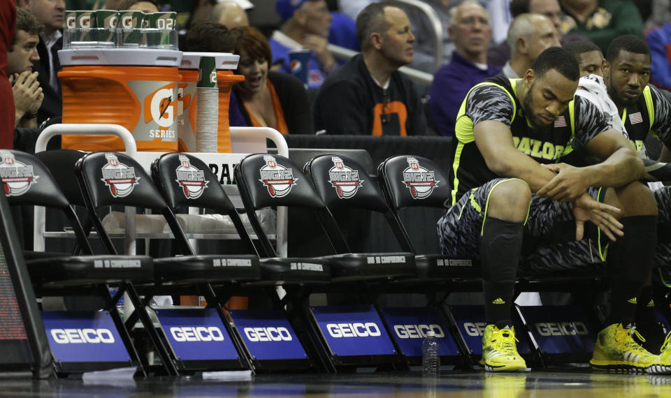 Baylor forward Rico Gathers (2) sits on the bench during a time out in the first half of an NCAA college basketball game against Oklahoma State in the Big 12 tournament on Thursday, March 14, 2013, in Kansas City, Mo. (AP Photo/Orlin Wagner)