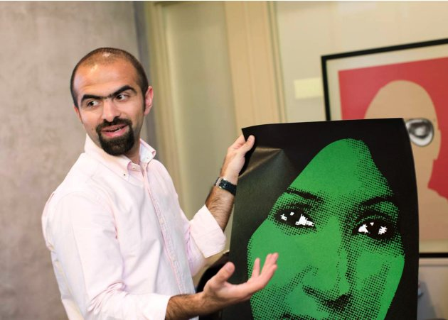 Kuwaiti graphic designer Mohammad Sharaf talks about his work in his office in Hawalli