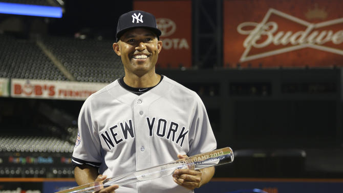 American League's Mariano Rivera, of the New York Yankees, poses with the MVP trophy after the MLB All-Star baseball game, on Tuesday, July 16, 2013, in New York. The American League defeated the National League 3-0. (AP Photo/Matt Slocum)