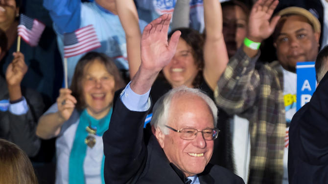 Democratic presidential candidate, Sen. Bernie Sanders, I-Vt., smiles and waves to the crowd at his primary night rally Tuesday, Feb. 9, 2016, in Concord, N.H. (AP Photo/J. David Ake)
