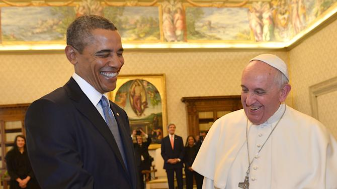 Pope Francis and President Barack Obama smile as they meet at the Vatican Thursday, March 27, 2014. A visibly energized President Barack Obama held a nearly hourlong audience with Pope Francis at the Vatican on Thursday, expressing his great admiration for the pontiff and inviting him to visit the White House. Although Obama and the church remain deeply split over abortion and contraception, Obama considers the pontiff a kindred spirit on issues of economic inequality, and their private meeting in the Papal Library ran longer than scheduled. (AP Photo/Gabriel Bouys, Pool)