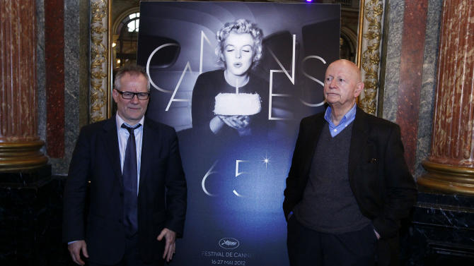 President of the Cannes Film Festival Gilles Jacob, left, and artistic Director Thierry Fremaux, pose in front of the Cannes International Film Festival poster for the upcoming 65th edition of the festival featuring US actress Marilyn Monroe during a press conference to announce this years festival line up in Paris, Wednesday April 19, 2012. The festival will run from May 16 to 27, 2012. (AP Photo/Francois Mori)
