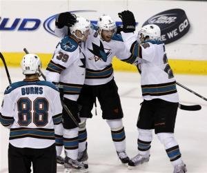 Couture leads Sharks in 5-2 win over Stars