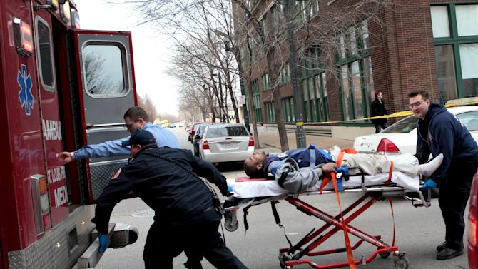 Police and emergency personnel transport a man to an ambulance after a shooting at Stephens Institute of Business and Arts on Washington Avenue in St. Louis on Tuesday, Jan. 15, 2013.  A part-time student strode into the office of a longtime administrator at the school and shot the man in the chest, creating panic in the school before turning the gun on himself, police said.  (AP Photo/St. Louis Post-Dispatch, David Carson) EDWARDSVILLE INTELLIGENCER OUT; THE ALTON TELEGRAPH OUT