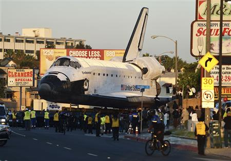 Space Shuttle Endeavour travels Manchester Blvd. enroute to the California Science Center during its final journey in Los Angeles, California, on October 13, 2012.