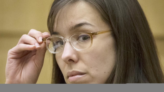 FILE - In this May 1, 2013 file photo, defendant Jodi Arias sits in the courtroom during her trial at Maricopa County Superior Court in Phoenix.  It has become a real-life soap opera for people around the world and dozens of fanatics who camp out on a Phoenix sidewalk to get into the show. The star is none other than a small-town waitress who killed her lover. Jodi Arias has been on trial since January, and her case has developed an enormous following with its tales of sex, violence and betrayal. (AP Photo/The Arizona Republic, Mark Henle, Pool, File)