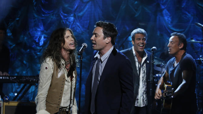 """In this photo provided by NBC, from left, Steven Tyler, Jimmy Fallon, Mark Rivera, and Bruce Springsteen, perform during """"Hurricane Sandy: Coming Together"""" Friday, Nov. 2, 2012, in New York. Hosted by Matt Lauer, the event is heavy on stars identified with New Jersey and the New York metropolitan area, which took the brunt of this week's deadly storm. (AP Photo/NBC, Heidi Gutman)"""