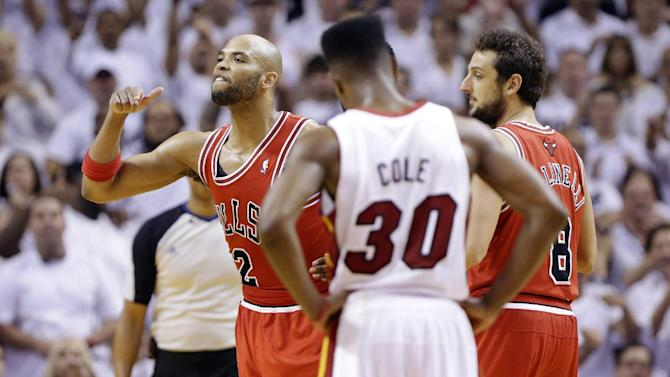 Chicago Bulls forward Taj Gibson, left, reacts after he was ejected during the second half of Game 2 of their NBA basketball playoff series in the Eastern Conference semifinals against the Miami Heat, Wednesday, May 8, 2013, in Miami. Chicago's Marco Belinelli and Miami's Norris Cole (30) stand by. The Heat won 115-78. (AP Photo/Lynne Sladky)