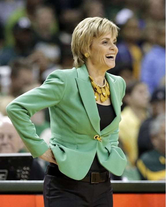 Baylor head coach Kim Mulkey smiles as she watches the team play against Texas in the second half of an NCAA college basketball game Saturday, Feb. 23, 2013, in Waco, Texas. Baylor defeated Texas 67-4