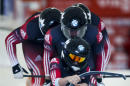 Canada's Kaillie Humphries, Dan Dale, Joey Nemet, and Douglas McLelland compete in the men's World Cup 4-man bobsled event in Calgary, Saturday, Dec. 20, 2014. (AP Photo/The Canadian Press, Jeff McIntosh)