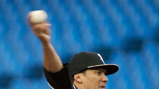 Chicago White Sox starting pitcher Hector Noesi works against the Toronto Blue Jays during first inning of a baseball game in Toronto, Ontario, Monday, May 25, 2015. (Nathan Denette/The Canadian Press via AP) MANDATORY CREDIT