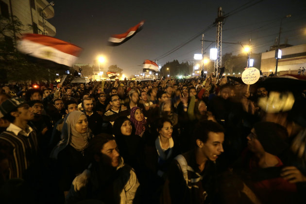 Egyptian protesters chant anti Muslim Brotherhood and Egyptian President Mosri slogans outside the presidential palace in Cairo, Egypt, Thursday, Dec. 6, 2012. The Egyptian army has deployed tanks out