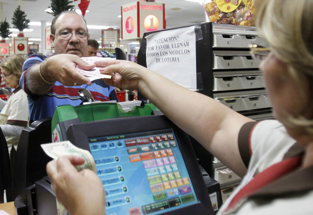 Maria Diaz, right, sells a customer Powerball tickets at a local supermarket in Hialeah, Fla.,Tuesday, Nov. 27, 2012. There has been no Powerball winner since Oct. 6, and the jackpot already has reach