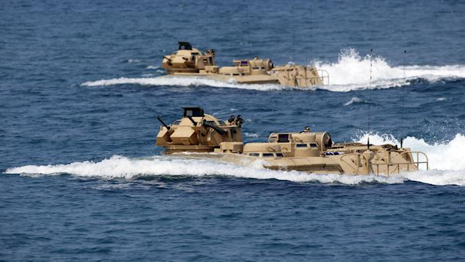 "U.S. military forces aboard AAV manuevre on South China Sea near the shore of San Antonio, Zambales during the annual ""Balikatan"" war games with Filipino soldiers"
