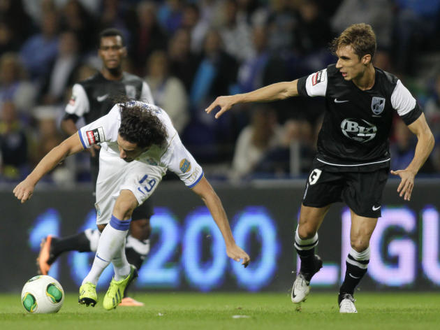 Porto's Lica battles for the ball with Guimaraes's Correia during their Portuguese Premier League soccer match at the Dragao stadium in Porto