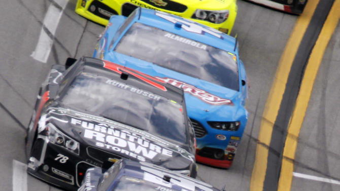 Matt Kenseth leads a pack of cars during the NASCAR Sprint Cup Series Aaron's 499 auto race at Talladega Superspeedway in Talladega, Ala., Sunday, May 5, 2013. (AP Photo/Butch Dill)