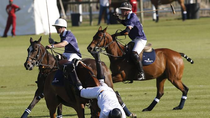 Britain's Prince Harry falls from his horse during the Sentebale Royal Salute Polo Cup in Paarl