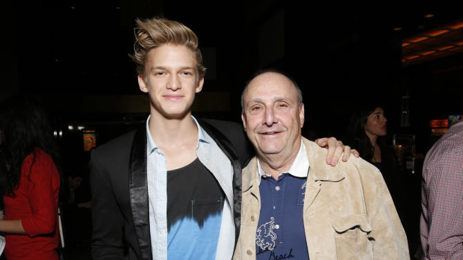 "Cody Simpson and Weinstein's Executive in Charge of Music Film/TV Richard Glasser attend the LA premiere of ""Escape from Planet Earth"" at the Chinese Theater on Saturday, Feb. 2,2013 in Hollywood. (Photo by Todd Williamson/Invision/AP Images)"