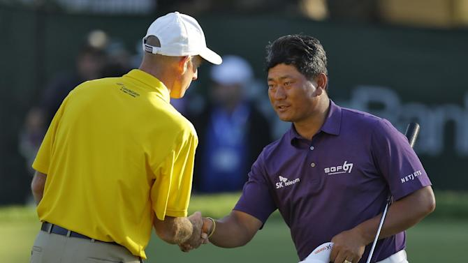 K.J. Choi, right, of South Korea, shakes hands with Jim Furyk after finishing during the second round of the Tampa Bay Championship golf tournament on Friday, March 15, 2013, in Palm Harbor, Fla. (AP Photo/Chris O'Meara)
