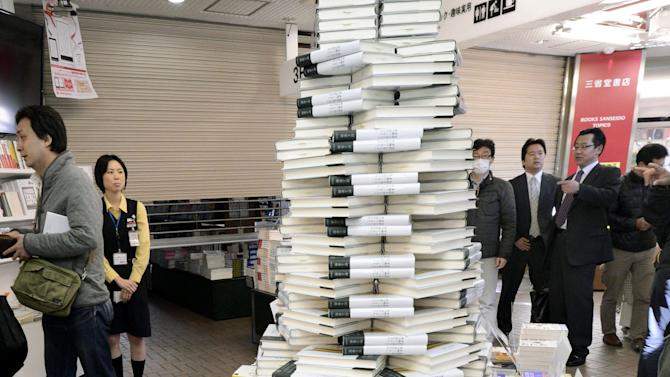 "Copies of the book "" Colorless Tsukuru Tazaki and his years of pilgrimage, "" the latest novel by Haruki Murakami are piled high at a book store in Tokyo Friday, April 12, 2013. Murakami's new novel, first in three years, went on sale on Friday. (AP Photo/Kyodo News)"