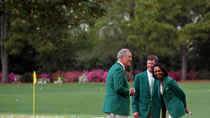 Condoleezza Rice, right, former Secretary of State and new Augusta National member, laughs on the practice range with members Dave Dorman, left, and Pat Battle, center, Sunday, April 7, 2013, at Augusta National Golf Club in Augusta, Ga. Rice and South Carolina financier Darla Moore were the first women invited to join the home course of the Masters. (AP Photo/Ron Williams)