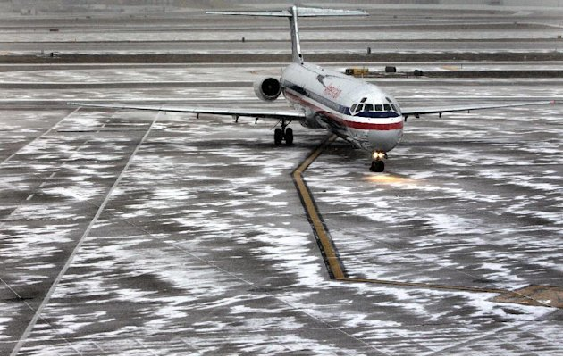 An American Airlines flight arrives as sleet falls at Lambert-St. Louis International Airport, on Thursday, Feb. 21, 2013. Blinding snow, at times accompanied by thunder and lightning, bombarded much 
