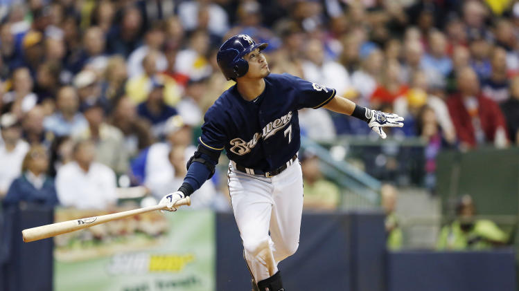 Milwaukee Brewers Norichka Aoki watches his deep fly ball off of Atlanta Braves pitcher Mike Minor during the fifth inning of a baseball game Monday, Sept. 10, 2012, in Milwaukee. (AP Photo/Tom Lynn)