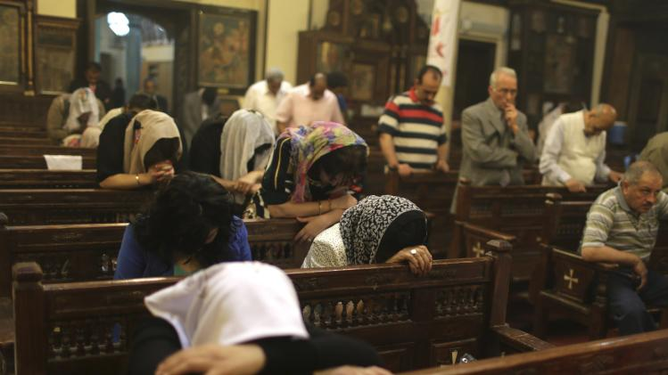 Copts pray during a vigil mass at a church, ahead of Easter, in old Cairo