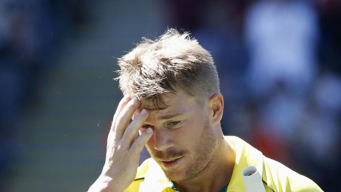 Australia's Warner walks off after being dismissed by New Zealand's Southee in their Cricket World Cup match in Auckland