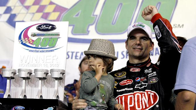 Jeff Gordon celebrates with his son Leo after his win in the NASCAR Sprint Cup auto race at Homestead-Miami Speedway in Homestead, Fla., Sunday, Nov. 18, 2012. (AP Photo/J Pat Carter)