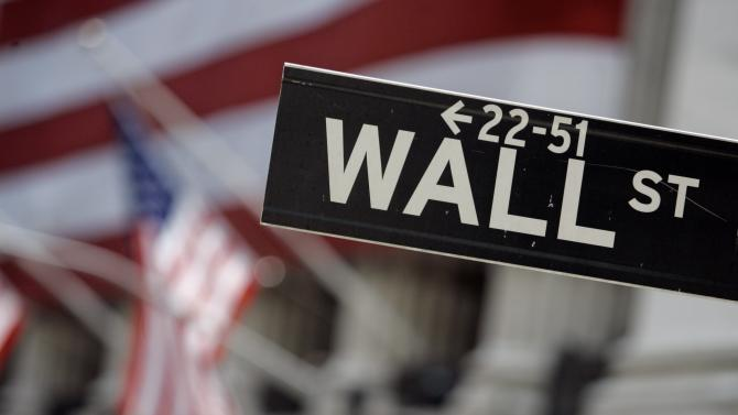 FILE - In this May 11, 2007, file photo, a Wall Street sign is mounted near the flag-draped facade of the New York Stock Exchange. U.S. stocks are dropping in early trading amid financial jitters in Europe and disappointing retail earnings. (AP Photo/Richard Drew, File)