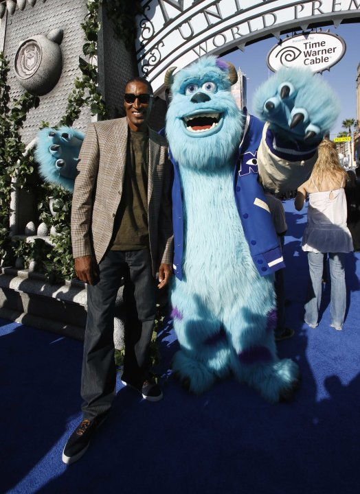 "Former NBA basketball player Scottie Pippen poses with a life-size character of Sullivan at the premiere of the film ""Monsters University"" at El Capitan theatre in Hollywood"