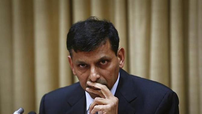 Raghuram Rajan, newly appointed governor of Reserve Bank of India (RBI), listens to a question during a news conference at the bank's headquarters in Mumbai September 4, 2013. REUTERS/Danish Siddiqui/Files