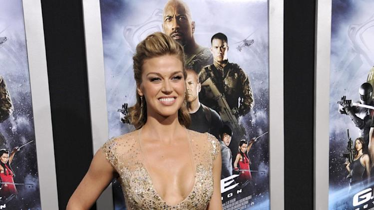"Adrianne Palicki, a cast member in ""G.I. Joe: Retaliation,"" poses at the Los Angeles premiere of the film at the TCL Chinese Theatre on Thursday, March 28, 2013 in Los Angeles. (Photo by Chris Pizzello/Invision/AP)"