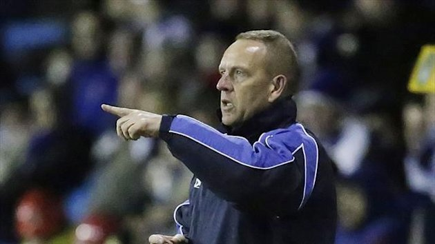 Kenny Shiels was satisfied with a share of the spoils