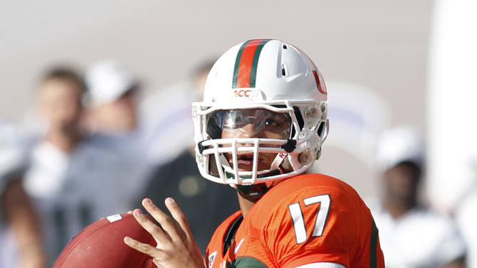 Miami quarterback Stephen Morris drops back to pass during the first half of an NCCA college football game against South Florida, Saturday, Nov. 17, 2012, in Miami. (AP Photo/Wilfredo Lee)