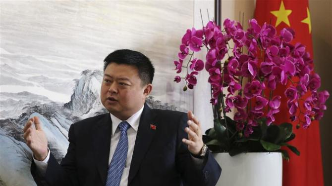 Chinese telecom tycoon Wang speaks during an interview with Reuters in Xinwei Telecom's headquarters in Beijing