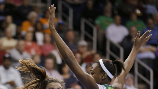 CORRECTS PLAYER AT RIGHT TO NOTRE DAME'S JEWELL LOYD, INSTEAD OF DUKE'S TRICIA LISTON - Duke's Haley Peters (33) gets a pass by Notre Dame guard Jewell Loyd during the first half of the regional final of the NCAA women's college basketball tournament Tuesday, April 2, 2013, in Norfolk, Va. (AP Photo/Steve Helber)