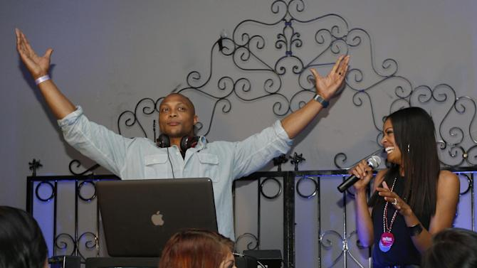 IMAGE DISTRIBUTED FOR PREMIERE GLOBAL SPORTS - Former NFL player Eddie George and NFL Network analyst Danyelle Sargent can be seen at the Premiere Global Sports Balcony Over Bourbon Party  in New Orleans, Louisiana on Friday, Feb. 1, 2013. (Scott Boehm /AP Images for Premiere Global Sports)