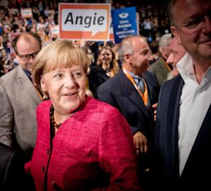German Chancellor Angela Merkel, arrives at the final stage of her election campaign in Berlin, Germany , Saturday, Sept. 21, 2013. General elections in Germany are scheduled for Sept. 22, 2013. Angela Merkel will run for her third term. (AP Photo/dpa, Michael Kappeler)