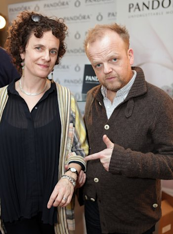 Toby Jones and friend like the Pandora bracelets given out at the HBO Luxury Lounge during Golden Globes weekend 2013.