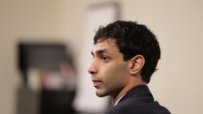 Dharun Ravi sits in the courtroom during his trial at the Middlesex County Courthouse in New Brunswick, N.J., Monday, March 5, 2012. Ravi is accused of using a webcam to spy on his roommate, Tyler Clementi, having an intimate encounter with another man. Days later Clementi committed suicide. Ravi, 19, faces 15 criminal charges, including invasion of privacy and bias intimidation, a hate crime punishable by up to 10 years in state prison. (AP Photo/The Star-Ledger, John O'Boyle, Pool)