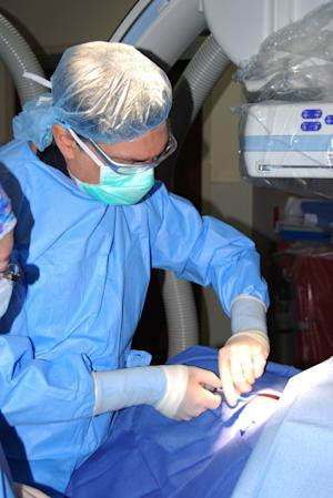 In this Wednesday, Oct. 31, 2012 photo provided by the University of Miami, Dr. Joshua M. Hare, director of the Interdisciplinary Stem Cell Institute, performs a heart biopsy, a preliminary step in one of several cardiac stem cell trials at the University of Miami Miller School of Medicine. Researchers are reporting key advances using stem cells to fix weakened, damaged hearts. In one study, bone marrow cells donated by unrelated strangers helped repair hearts, suggesting that cells could be banked for off-the-shelf use in patients after heart attacks the way blood is banked now. (AP Photo/University of Miami)