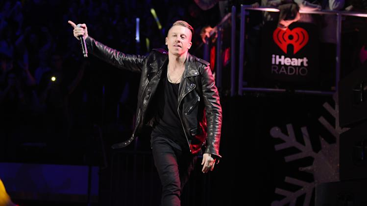FILE - This Dec. 13, 2013 file photo shows Macklemore performing at Z100's Jingle Ball 2013 in New York. The Seattle rapper was named The Source's 2013 Man Of The Year. (Photo by Evan Agostini/Invision/AP, File)