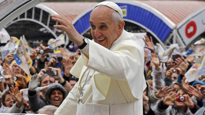 Pope Francis waves to pilgrims from his popemobile as he arrives to the Aparecida Basilica in Aparecida, Brazil, Wednesday, July 24, 2013. It was no coincidence that the first major event of his first foreign trip as pope was a Mass in Aparecida. The shrine, which draws 11 million pilgrims a year, hosted a critical 2007 meeting of Latin American bishops attended by then-Cardinal Jorge Mario Bergoglio. (AP Photo/Enric Marti)
