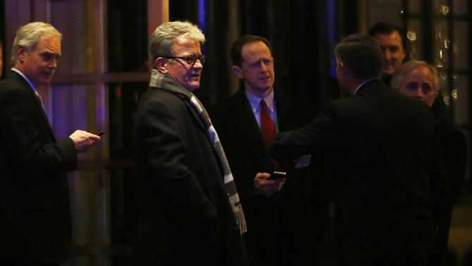 Sen. Ron Johnson, R-Wis., left, Sen. Tom Coburn, R-Okla., second left, Sen. Pat Toomey, R-Pa., and others leave after a private dinner with President Barack Obama at the Jefferson Hotel in Washington, Wednesday, March 6, 2013. (AP Photo/Charles Dharapak)
