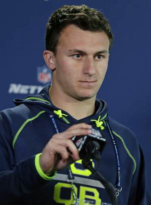 Texas A&M quarterback Johnny Manziel answers a question during a news conference at the NFL football scouting combine in Indianapolis, Friday, Feb. 21, 2014. (AP Photo/Michael Conroy)