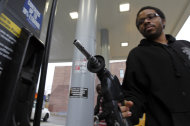 In this Feb. 24, 2012 photo, Michael Morris replaces the nozzle after putting gas in his car, in Philadelphia. A sharp jump in gas prices drove a measure of US consumer costs up in February. But outside higher pump prices, inflation stayed mild. (AP Photo/Alex Brandon)